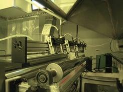 Lumetrics non contact thickness measurement system